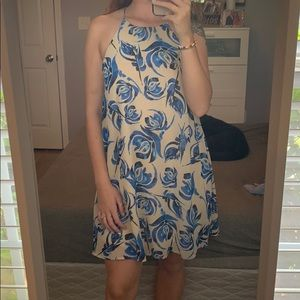 Nude dress with blue floral print.
